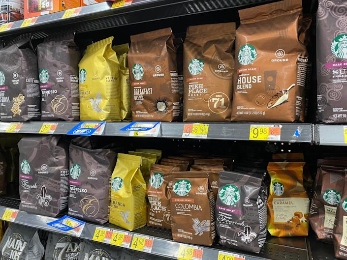 shelving filled with cheap starbucks coffee at a walmart