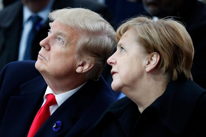 In this Sunday, Nov. 11, 2018 file photo, U.S President Donald Trump and German Chancellor Angela Merkel attend ceremonies at the Arc de Triumphe in Paris.