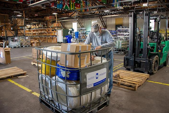 A man packs up a plumbing supplies shipment leaving Water Mission's Charleston, S.C., headquarters. (Water Mission)