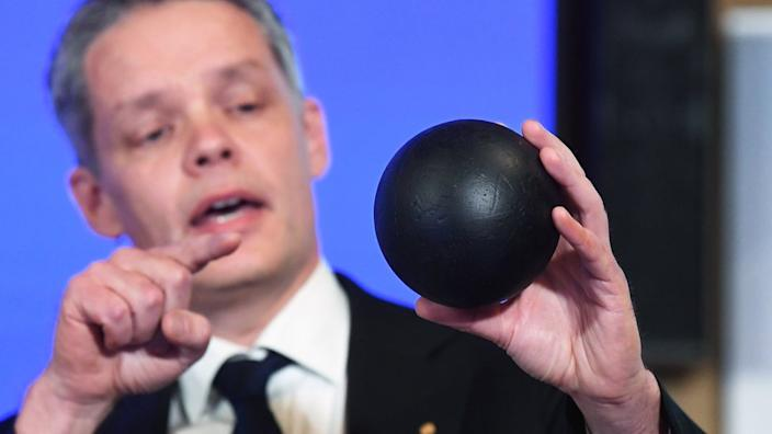 At the announcement of this year's recipients, Ulf Danielsson demonstrates the concept of a black hole using a ball