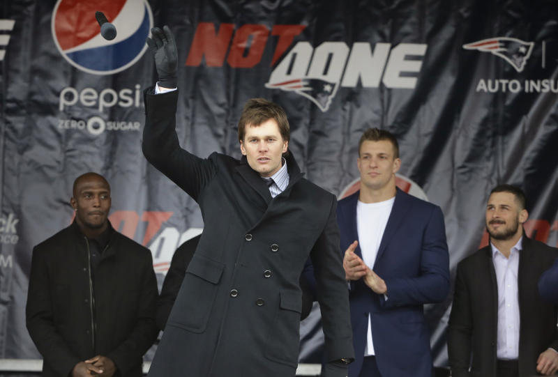 Tom Brady, addressing a crowd at the Patriots' Super Bowl send-off rally on Monday, took issue with criticism of his daughter. (AP)