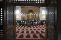 """Muslims offer Eid al-Adha prayers in Kabul, Afghanistan, Tuesday, July 20, 2021. Eid al-Adha, or """"Feast of the Sacrifice,"""" commemorates the Quranic tale of Prophet Ibrahim's willingness to sacrifice his son as an act of obedience to God. (AP Photo/Rahmat Gul)"""