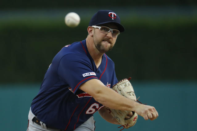 FILE - In this Sept. 25, 2019, file photo, Minnesota Twins pitcher Randy Dobnak throws a warmup pitch in the first inning of a baseball game against the Detroit Tigers in Detroit. The Twins remain publicly confident in the rotation anchored by returning veterans Jose Berrios and Jake Odorizzi and supplemented by youngsters like Devin Smeltzer, Dobnak and Lewis Thorpe. (AP Photo/Paul Sancya, File)