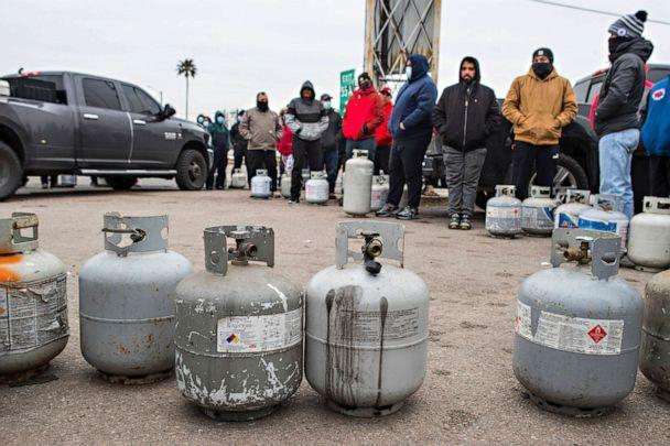 PHOTO: People line up to fill their empty propane tanks on Feb. 16, 2021, in Houston. Temperatures stayed below freezing Tuesday, and many residents were without electricity. (Brett Coomer/AP)