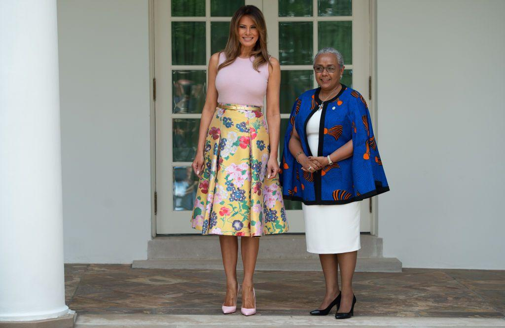 <p>Melania Trump wore a yellow floral skirt with a light pink top and matching pumps while meeting with Margaret Kenyatta, wife of the Kenyan President.</p>