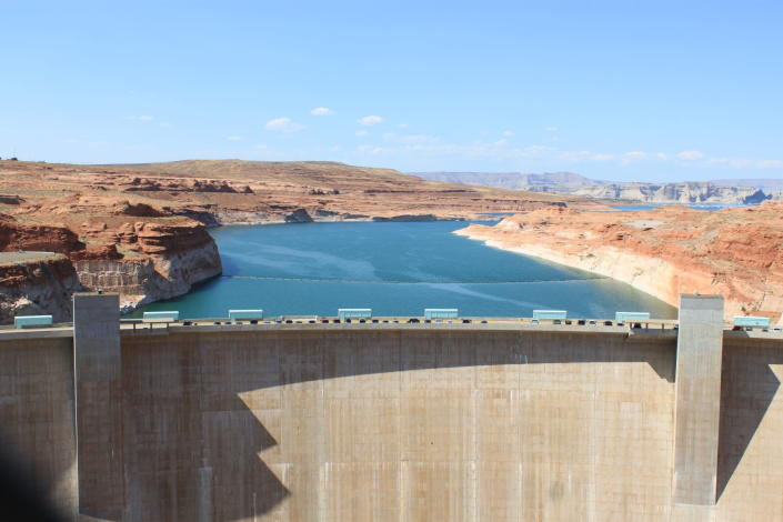 This Aug. 21, 2019 image shows Glen Canyon Dam near Page, Arizona, holding back Lake Powell. A plan by Utah could open the door to the state pursuing an expensive pipeline that critics say could further deplete the lake, which is a key indicator of the Colorado River's health. (AP Photo/Susan Montoya Bryan)