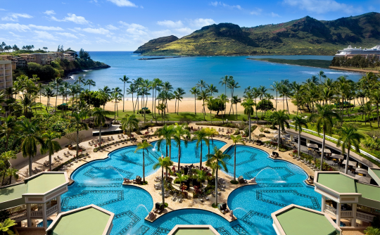 """<p>With five al fresco restaurants (including a poolside bar serving Pacific Rim cuisine), a Jack Nicklaus–designed golf course, and the largest swimming pool (26,000 square feet) in Hawaii, <a href=""""http://www.marriott.com/hotels/travel/lihhi-kauai-marriott-resort/"""" rel=""""nofollow noopener"""" target=""""_blank"""" data-ylk=""""slk:this property"""" class=""""link rapid-noclick-resp"""">this property</a> has big things to offer families. All 345 guest rooms are equipped with refrigerators and high-speed Wi-Fi streamlined décor. The 800 manicured beachfront acres facing Kalapaki Bay allow kids and adults to indulge in water sports all day long. (Photo: Courtesy of Marriott)</p>"""