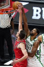 Boston Celtics center Tristan Thompson, right, blocks a shot by Chicago Bulls guard Tomas Satoransky during the first half of an NBA basketball game in Chicago, Friday, May 7, 2021. (AP Photo/Nam Y. Huh)