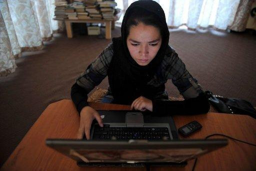 An Afghan ethnic Hazara woman browses the Facebook website on a computer at Kabul's Young Women For Change, Afghanistan's first women-only Internet cafe. Afghans are using Twitter and Facebook to bring about social change, particularly women, who are largely marginalised in what is a deeply conservative, male-dominated society