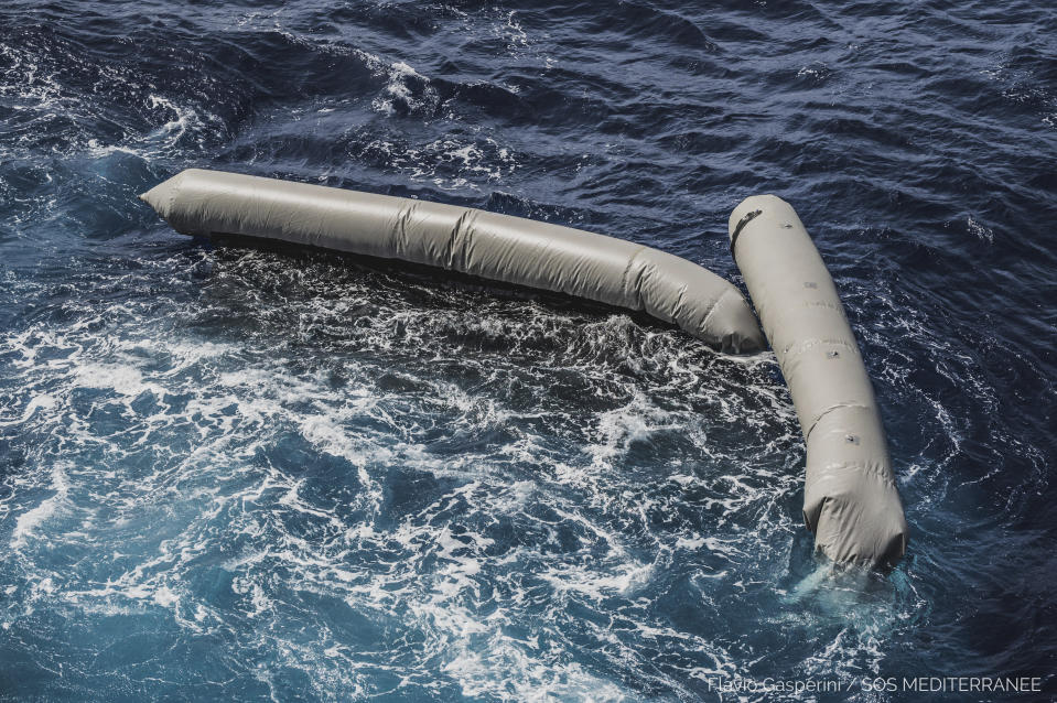 Debris from a dinghy which was supposedly carrying over 100 migrants are seen floating in the Mediterranean Sea northeast of the Libyan capital, Tripoli, Thursday, April 22, 2021. SOS Mediterranee, which operates the rescue vessel Ocean Viking, said late Thursday that the wreck of a rubber boat, which was initially carrying around 130 people, was spotted in the Mediterranean Sea. The aid vessel did not find any survivors, but could see at least ten bodies near the wreck, the group added in a statement. (Flavio Gasperini/SOS Mediterranee via AP)