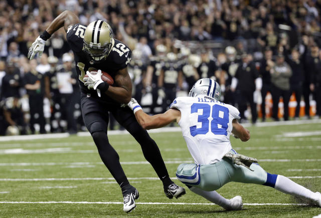 New Orleans Saints wide receiver Marques Colston (12) eludes Dallas Cowboys defensive back Jeff Heath (38) on a touchdown reception in the first half of an NFL football game in New Orleans, Sunday, Nov. 10, 2013. (AP Photo/Dave Martin)