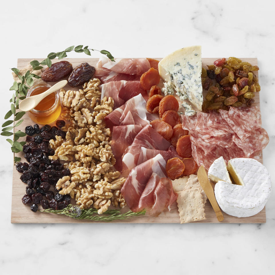 """<p>This DIY kit comes complete with everything you need to assemble the most beautiful Instagram-worthy charcuterie platter, including visual aids and a serving board. It also happens to be absolutely delicious!</p> <p><strong>$179.95, <a href=""""https://williams-sonoma.pdy5.net/c/249354/265127/4291?u=https%3A%2F%2Fwww.williams-sonoma.com%2Fproducts%2Flady-and-larder-medium-cheese-board%2F%3F_br_psugg_q%3Dlady%2Band%2Blarder&subid1=EWMothersDayGiftGuideBKaplan0421"""" rel=""""nofollow noopener"""" target=""""_blank"""" data-ylk=""""slk:williams-sonoma.com"""" class=""""link rapid-noclick-resp"""">williams-sonoma.com</a></strong></p>"""