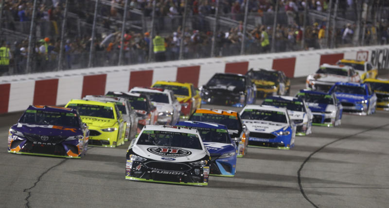 Kevin Harvick (4) leads the field at the start of the NASCAR Cup Series auto race at Richmond Raceway in Richmond, Va., Saturday, Sept. 22, 2018. (AP Photo/Steve Helber)