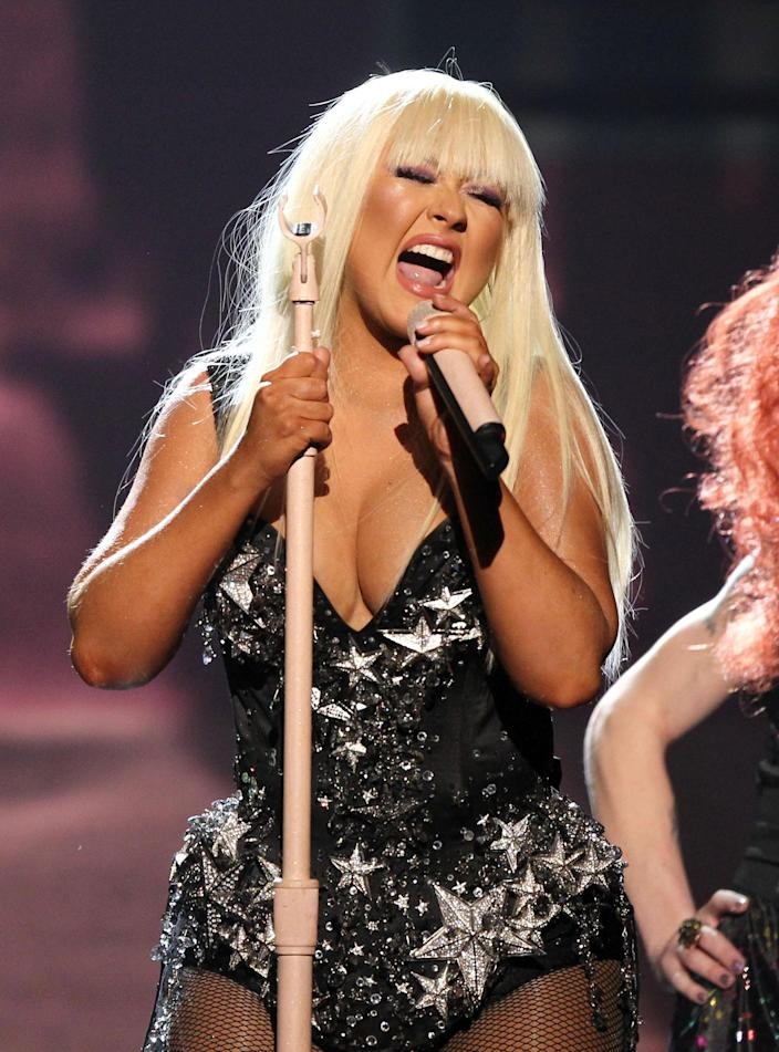 "Christina Aguilera performs ""Lotus"", ""Army of Me"" and ""Let There Be Love"" at the 40th Anniversary American Music Awards on Sunday, Nov. 18, 2012, in Los Angeles. (Photo by Matt Sayles/Invision/AP)"