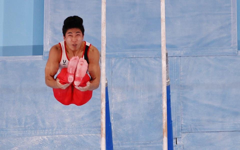 ee Junho of South Korea in action on the parallel bars. - REUTERS