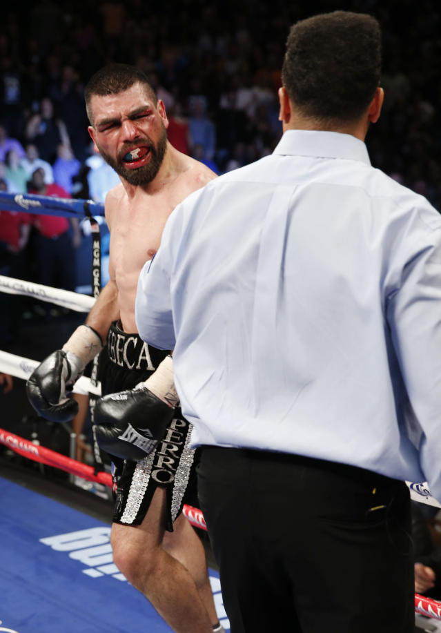 Alfredo Angulo of Mexicali Mexico reacts to referee Tony Weeks stopping of the fight in the 10th round against Saul Alvarez of Guadalajara Mexico during their super welterweight boxing match, Saturday, March 8, 2014, at The MGM Grand Garden Arena in Las Vegas. Alvarez won by TKO