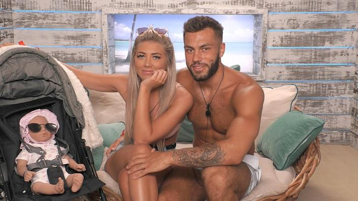 <em>Winter Love Island</em> 2020 winners Paige Turley and Finn Tapp play at being parents on the show. (ITV)