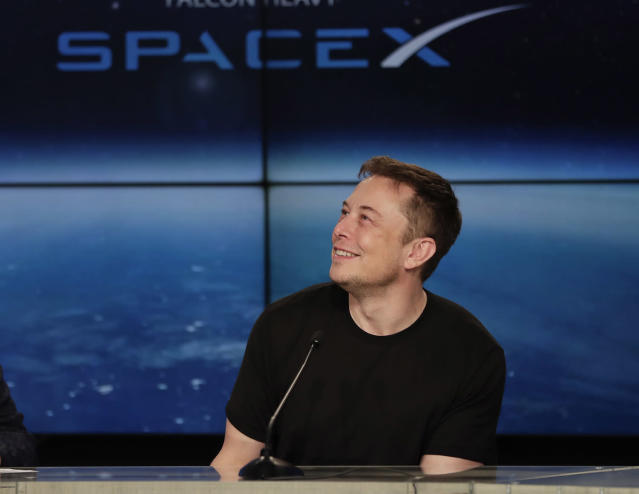 <p>Elon Musk, founder, CEO, and lead designer of SpaceX, speaks at a news conference after the Falcon 9 SpaceX heavy rocket launched successfully from the Kennedy Space Center in Cape Canaveral, Fla., Tuesday, Feb. 6, 2018. (Photo: John Raoux/AP) </p>