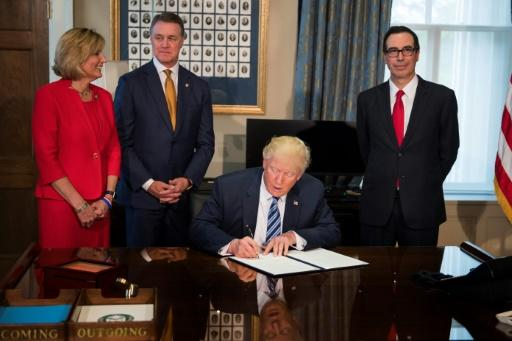 Trump takes aim at US financial oversight law