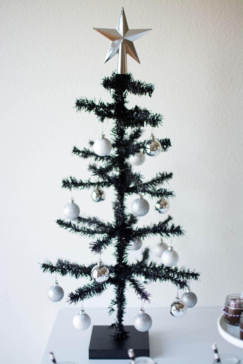 "<p>There is unmistakable charm in a scroungy tree, as our favorite animated holiday movie once taught. Adorn a skinny Christmas tree with simple silver ornaments to give a little tree big spirit, as <a href=""http://www.twinkletwinklelittleparty.com/host-a-gingerbread-party/"" rel=""nofollow noopener"" target=""_blank"" data-ylk=""slk:Twinkle Twinkle Little Party"" class=""link rapid-noclick-resp"">Twinkle Twinkle Little Party</a> brilliantly did here. </p>"