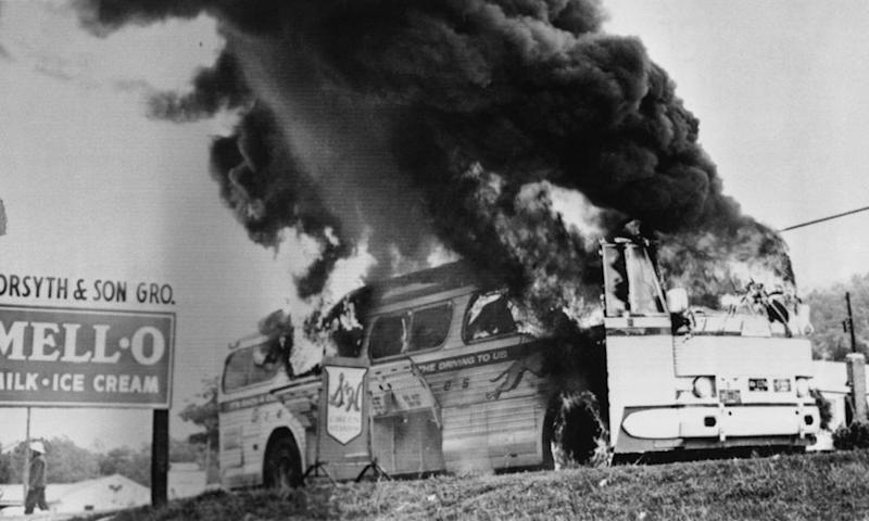 A Freedom Rider bus in flames in May 1961 near Anniston, Alabama.