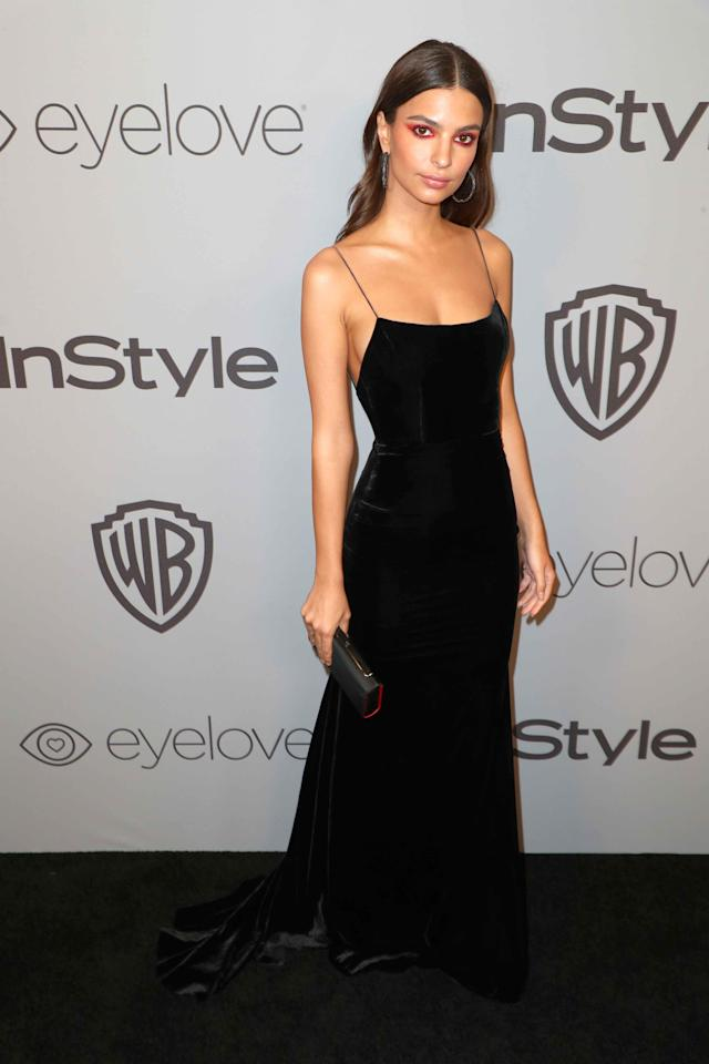 <p>Hollywood's brightest stars orchestrated a blackout on the Golden Globes red carpet in response to the multiple sexual assault and harassment allegations rocking the industry. The theme continued at the Golden Globes on the black carpet at the In Style after party. Emily Ratajkowski wore a simple black gown with some bold red eyeshadow to compliment her look.</p>