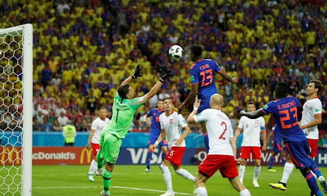 Soccer Football - World Cup - Group H - Poland vs Colombia - Kazan Arena, Kazan, Russia - June 24, 2018 Colombia's Yerry Mina scores their first goal REUTERS/John Sibley