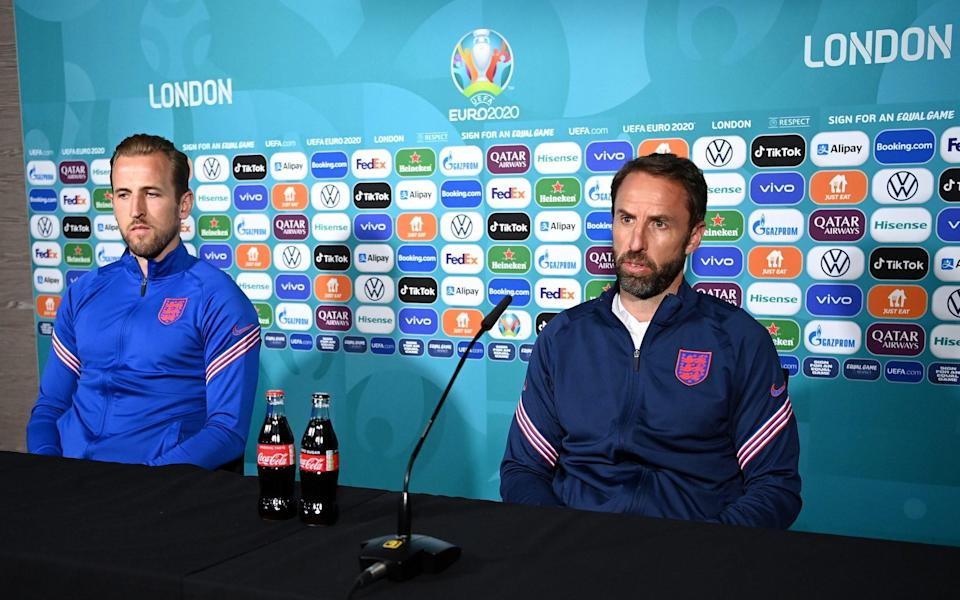 The bottles stayed front and centre during England's press conference - GETTY IMAGES