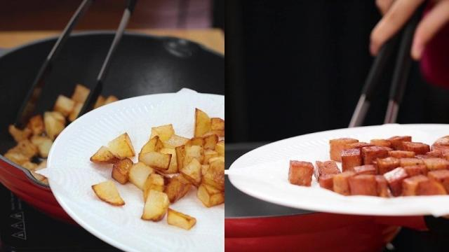 Frying potatoes and luncheon meat in a pan