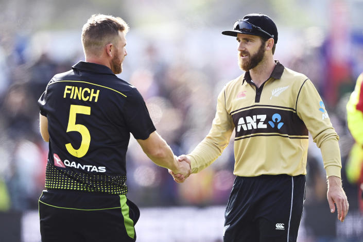 Australian captain Aaron Finch, left, shakes hands with New Zealand captain Kane Williamson after their second T20 cricket international between Australia and New Zealand at University Oval In Dunedin, New Zealand, Thursday, Feb. 25, 2021. (Andrew Cornaga/Photosport via AP)