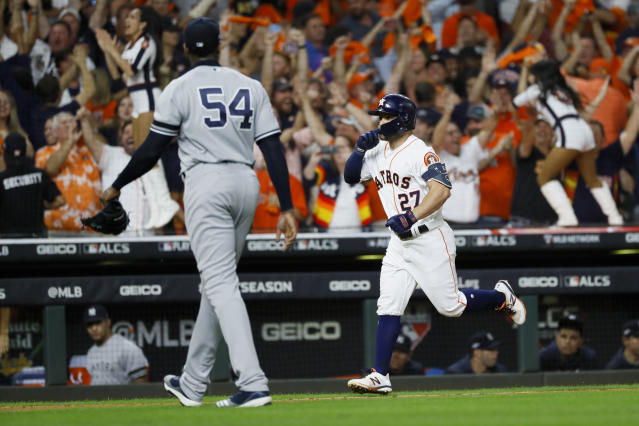 Houston's Jose Altuve (27) celebrates after a walk-off home run off Yankees pitcher Aroldis Chapman to win the American League on Saturday. (AP)