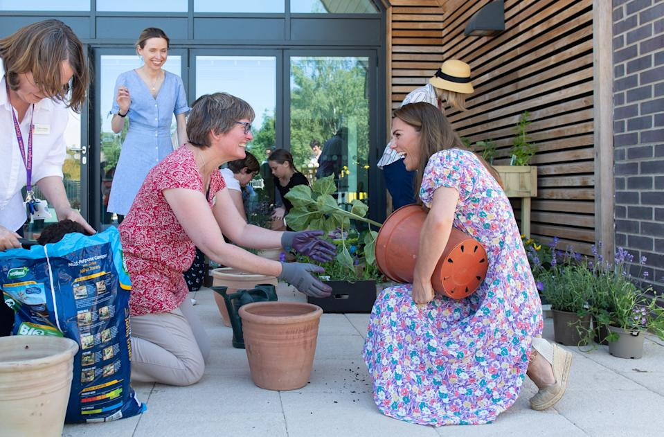 EMBARGOED: No onward transmission before 2100 BST Sat 27/6/2020. Not for publication before 2200 BST Sat 27/6/2020. The Duchess of Cambridge helps to pot plants and herbs during a visit to The Nook in Framlingham Earl, Norfolk, which is one of the three East Anglia Children's Hospices (EACH).