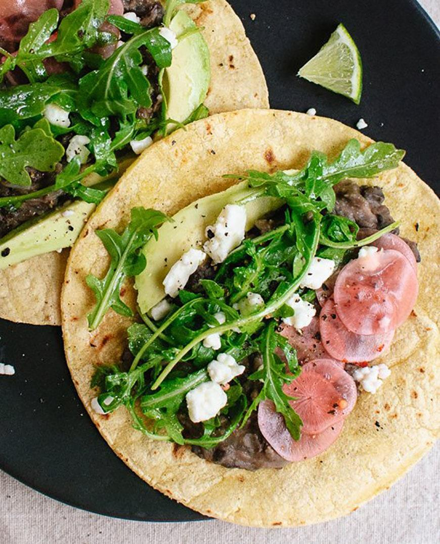 """<p>A handful of arugula, bright pickled radishes, and tart feta keep this black bean taco fresh and exciting.</p> <p>Get the recipe <a href=""""https://cookieandkate.com/2014/fresh-arugula-and-black-bean-tacos-with-pickled-radish-and-feta/#_a5y_p=1775612"""" rel=""""nofollow noopener"""" target=""""_blank"""" data-ylk=""""slk:here"""" class=""""link rapid-noclick-resp"""">here</a>.</p>"""