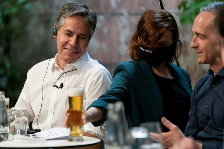 US Secretary of State Antony Blinken and German Foreign Minister Heiko Maas have a beer together in Berlin in June 2021 as relations between the allies dramatically improve under President Joe Biden