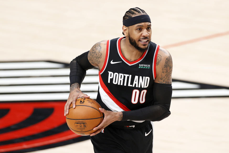 Carmelo Anthony #00 of the Portland Trail Blazers looks to pass in the first quarter against the Denver Nuggets during Round 1, Game 4 of the 2021 NBA Playoffs at Moda Center on May 29, 2021 in Portland, Oregon. NOTE TO USER: User expressly acknowledges and agrees that, by downloading and or using this photograph, User is consenting to the terms and conditions of the Getty Images License Agreement. (Photo by Steph Chambers/Getty Images)