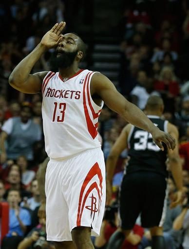 HOUSTON, TX - MARCH 24: James Harden #13 of the Houston Rockets celebrates a three point basket during the game against the San Antonio Spurs at Toyota Center on March 24, 2013 in Houston, Texas. (Photo by Scott Halleran/Getty Images)