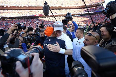 Jan 19, 2014; Denver, CO, USA; Denver Broncos head coach John Fox and quarterback Peyton Manning (18) celebrate after the 2013 AFC championship playoff football game against the New England Patriots at Sports Authority Field at Mile High. Mandatory Credit: Matthew Emmons-USA TODAY Sports