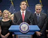 FILE - In this Dec. 3, 2012, file photo, New York Gov. Andrew Cuomo is joined by the New York Congressional delegation including, Sen. Kirsten Gillibrand, left, and Sen. Charles Schumer, right, for a news conference at the Capitol in Washington. Schumer and Gillibrand on Friday, March 12, 2021, are calling on Cuomo to resign, adding the most powerful Democratic voices yet to calls for the governor to leave office in the wake of allegations of sexual harassment and groping. (AP Photo/J. Scott Applewhite, File)
