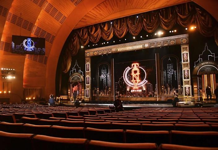 """FILE - A view of the stage appears prior to the start of the 73rd annual Tony Awards at Radio City Music Hall in New York on June 9, 2019. Tony Award Productions said Friday that the celebration of live theater will be digital but offered no date or streaming platform. Final eligibility determinations will be made by the Tony Awards Administration Committee """"in the coming days."""" Broadway theaters abruptly closed on March 12, knocking out all shows — including 16 that were still scheduled to open. (Photo by Charles Sykes/Invision/AP, File)"""