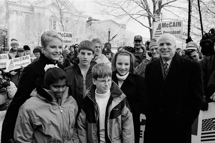 McCain at a rally in the park with his family: daughter Bridget, wife Cindy, sons Jack and Jimmy, and daughter Meghan, on Jan. 31, 2000, in Keene, New Hampshire.