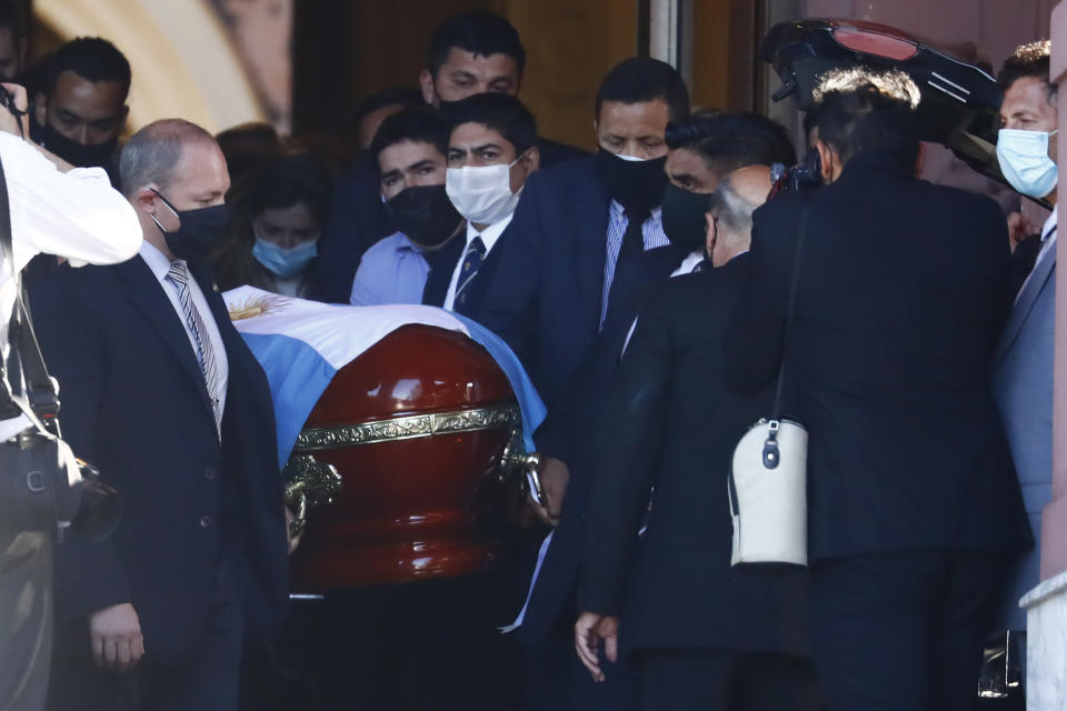 The flag-draped casket of Diego Maradona