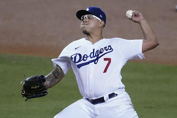 Los Angeles Dodgers reliever Julio Urias throws to an Oakland Athletics batter during the fourth inning of a baseball game Wednesday, Sept. 23, 2020, in Los Angeles. (AP Photo/Marcio Jose Sanchez)