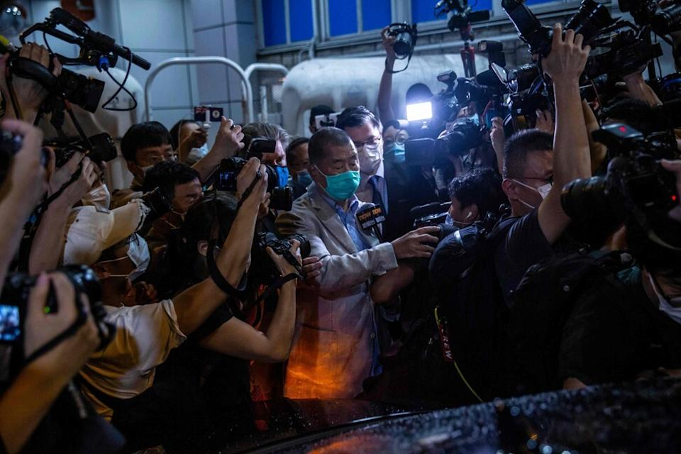 Jimmy Lai moves through the media scrum on his release from custody. Photo: AFP