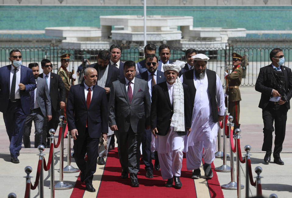 President Ashraf Ghani, center, arrives to attend an extraordinary meeting of the Parliament in rightKabul, Afghanistan, Monday, Aug. 2, 2021. (AP Photo/Rahmat Gul)
