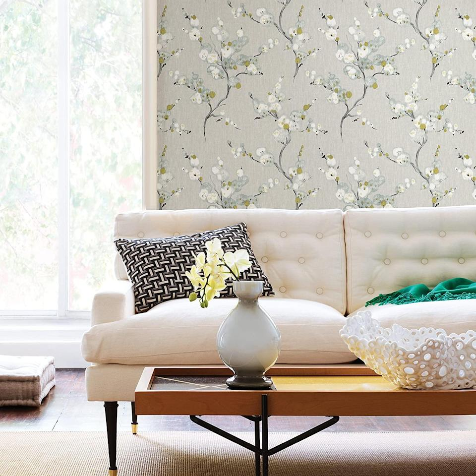 "<p>Floral wallpaper doesn't have to be a symphony in chintz. Fresh and modern florals can add just the right oomph to an accent wall, powder room, entry hall—endless possibilities. Bonus: Peel-and-stick simplifies the process considerably.</p> <p><strong>BUY IT: </strong>NuWallpaper NU2679 Mirei Peel & Stick Wallpaper, $27.30/30.75 square feet; <a href=""https://www.amazon.com/NuWallpaper-NU2679-Mirei-Stick-Wallpaper/dp/B07FRDZ5NF?&linkCode=ll1&tag=slthingsfromgrandmothershousevluesse0321-20&linkId=6dc5d73db220125db336685308e4f8b6&language=en_US&ref_=as_li_ss_tl"" rel=""sponsored noopener"" target=""_blank"" data-ylk=""slk:Amazon.com"" class=""link rapid-noclick-resp"">Amazon.com</a></p>"