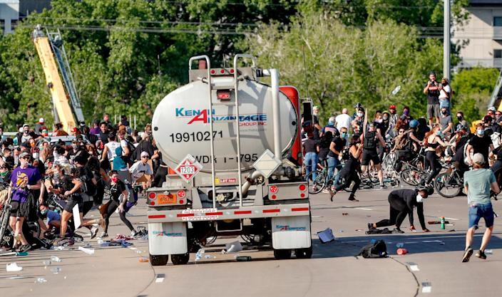 Image: Tanker truck drives into protesters on bridge (Eric Miller / Reuters)