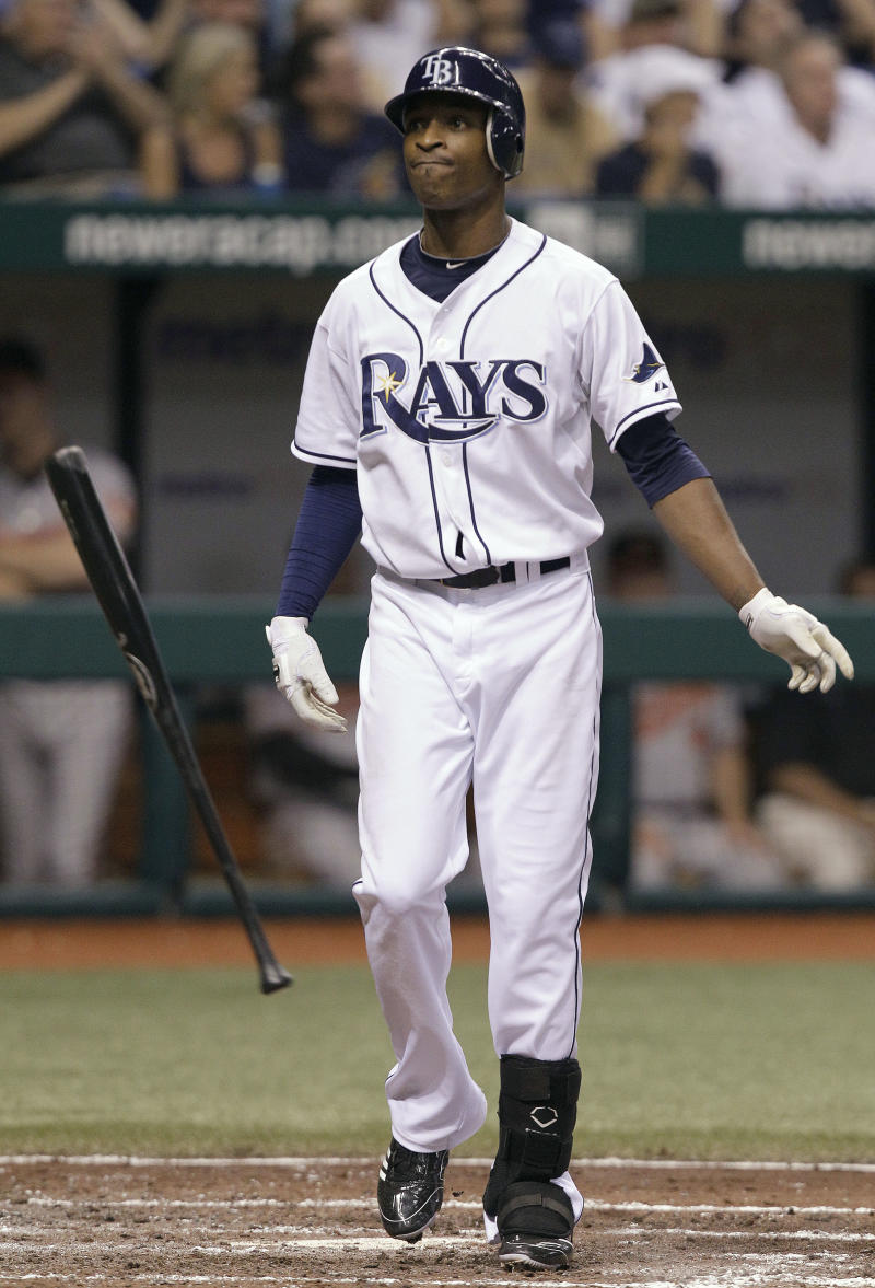 Tampa Bay Rays' B.J. Upton flings his bat after striking out against Baltimore Orioles starting pitcher Kevin Millwood with the bases loaded during the seventh inning of a baseball game Wednesday, Sept. 29, 2010, in St. Petersburg, Fla. (AP Photo/Chris O'Meara)