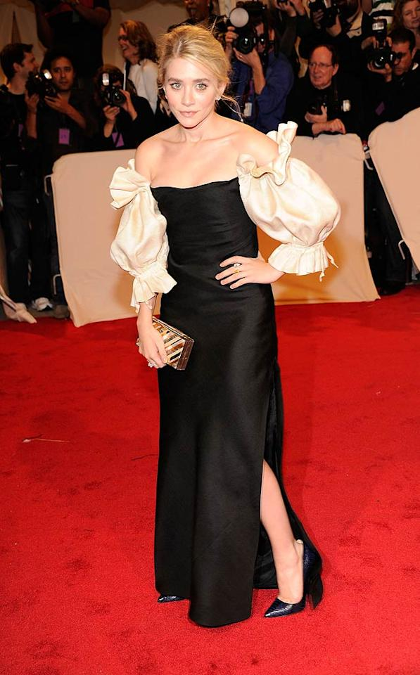 "Mary-Kate's sister also went vintage in a black-and-cream Christian Dior couture number with billowy, off-the-shoulder sleeves. Her sweeping updo and gold Judith Leiber clutch complemented the classic look. Kevin Mazur/<a href=""http://www.wireimage.com"" target=""new"">WireImage.com</a> - May 2, 2011"