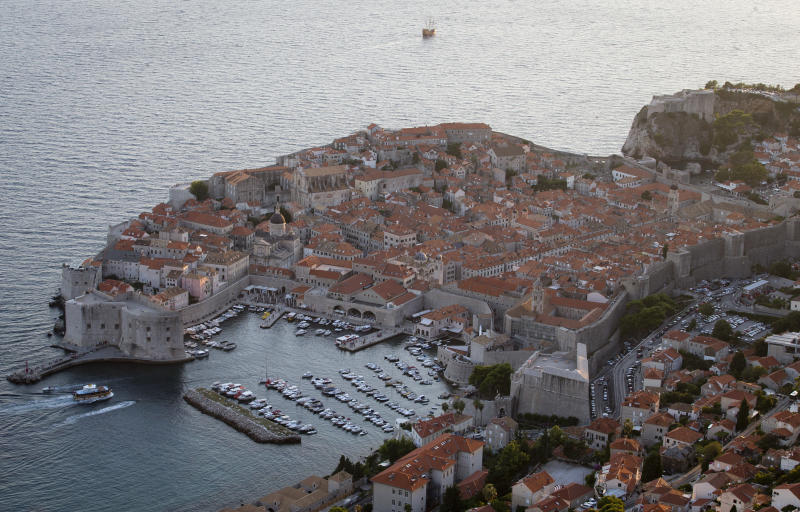This Sept. 4, 2018 photo shows the old town of Dubrovnik from a hill above the city. Crowds of tourist are clogging the entrances into the ancient walled city, a UNESCO World Heritage Site, as huge cruise ships unload thousands more daily. (AP Photo/Darko Bandic)