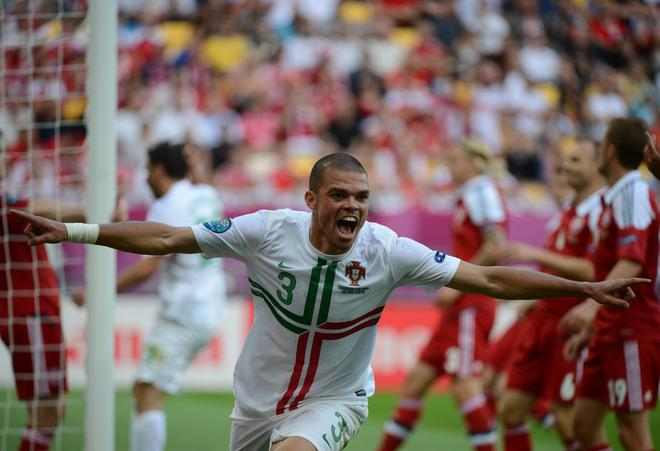 TOPSHOTS Portuguese defender Pepe celebrates after scoring a goal during the Euro 2012 championships football match Denmark vs Portugal on June 13, 2012 at the Arena Lviv. AFP PHOTO / DAMIEN MEYERDAMIEN MEYER/AFP/GettyImages